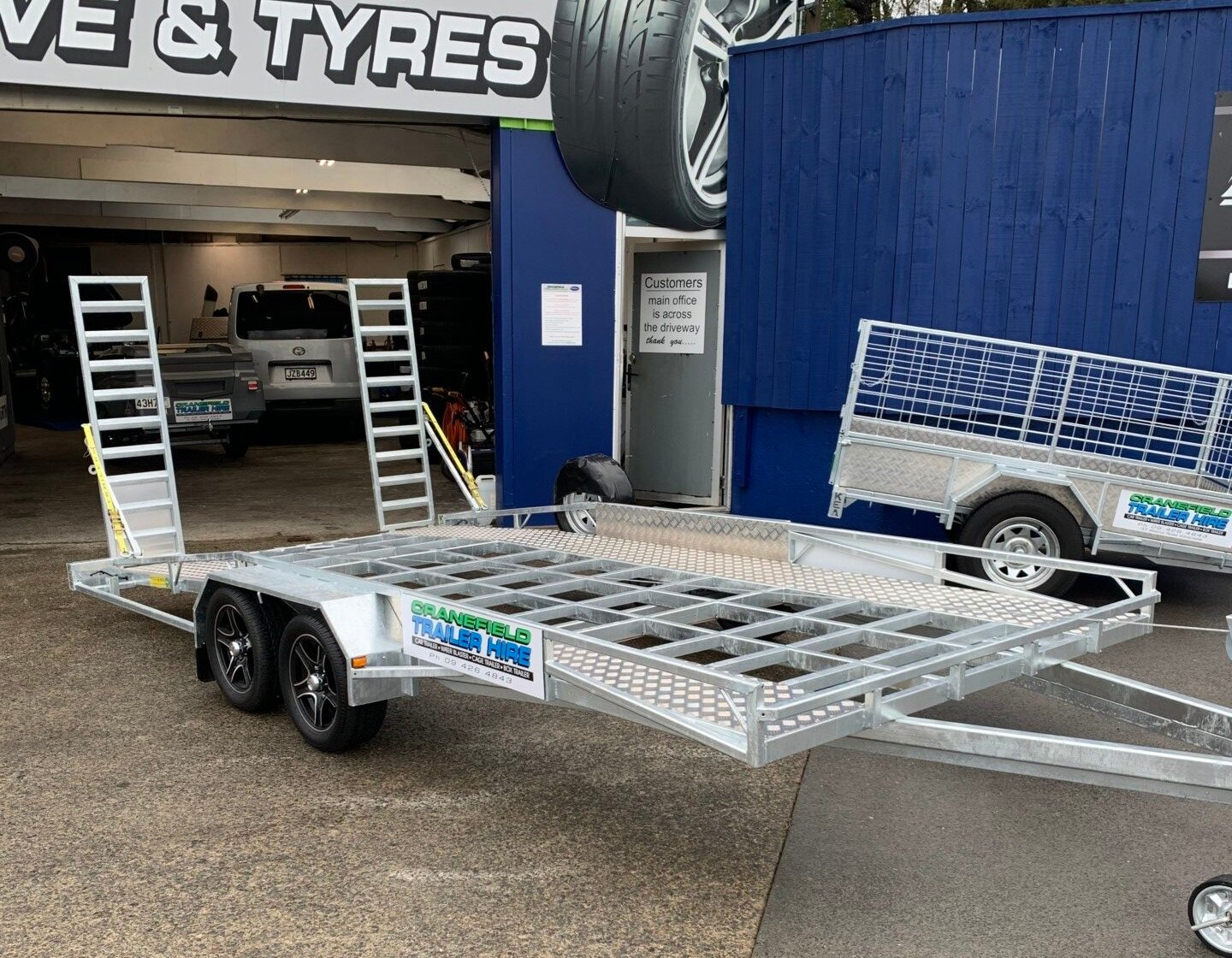 car transporting trailer for hire rotated